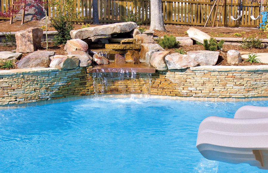 Rock waterfall pool photos blue haven pools Swimming pools with waterfalls and slides
