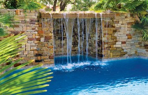 Swimming pool with rock waterfall grotto