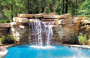 Swimming pool with rock waterfall