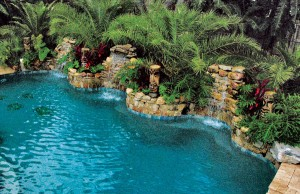 Large rock waterfalls flowing into pool