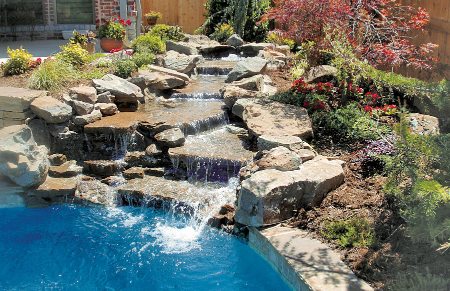 Rock waterfalls blue haven custom swimming pool and spa for Rock waterfall