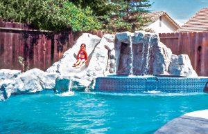 rock-waterfall-slide-pool-260