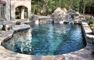 Free form swimming pool with rock water slide and spa
