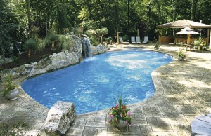 Free form swimming pool with rock waterfall