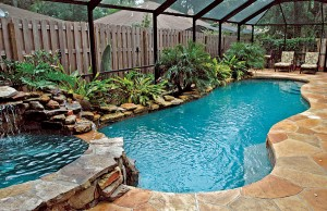 Free form swimming pool with rock waterfall and spa