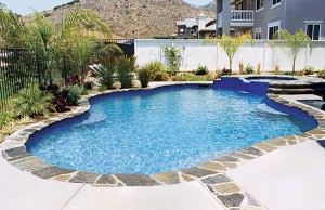 Free form pool with cascade spa