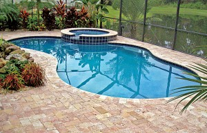 Free form swimming pool with cascade spa