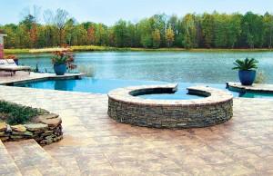 vanishing edge pool with spa overlooking pond