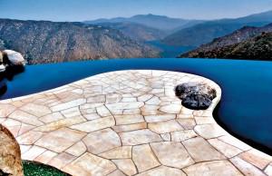 infinity edge pool overlooking mountain range