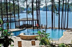 vanishing edge pool and spa next to lake