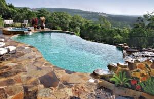 infinity edge pool with rock waterfall and spa