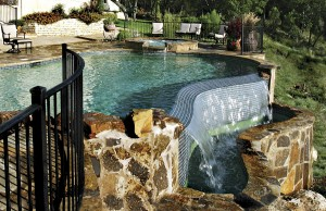 vanishing edge pool with spa and rock waterfall