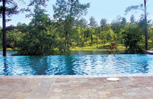 infinity edge pool next to lake