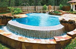 vanishing edge pool with rock waterfall and spa